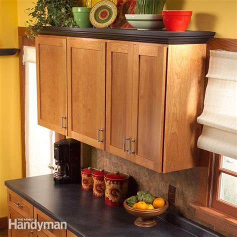 add shelves to cabinets how to add shelves above kitchen cabinets