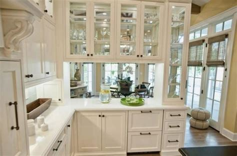 white kitchen cabinets with glass doors decorating with glass cabinets doors brings light into