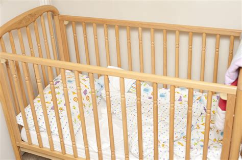 colored baby cribs free stock photo 11954 empty wooden baby crib freeimageslive