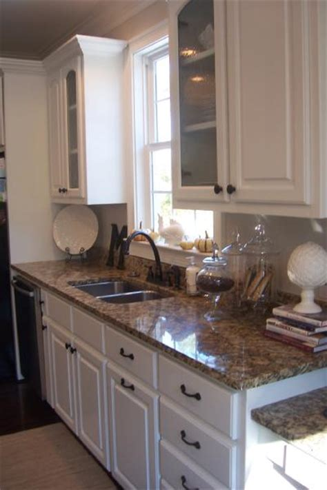 white kitchen cabinets with granite countertops santa cecilia granite traditional kitchen