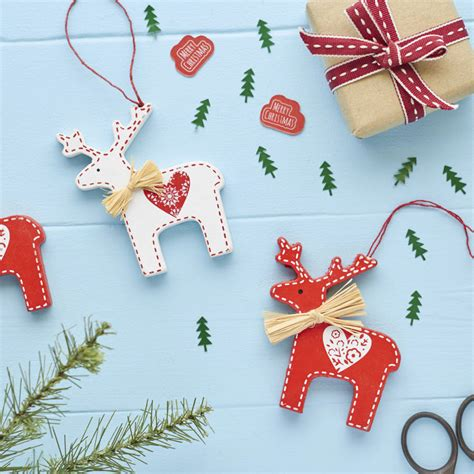 white reindeer decorations and white reindeer decoration by the