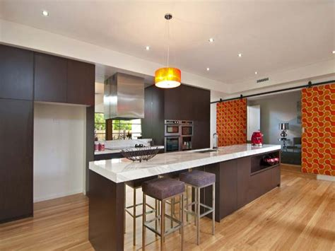 modern kitchen designs with island modern island kitchen design using floorboards kitchen photo 318544