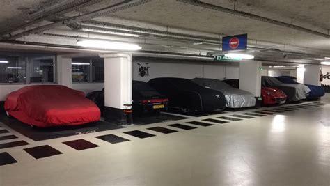 underground parking garage 2of2 covered supercars in underground parking garage