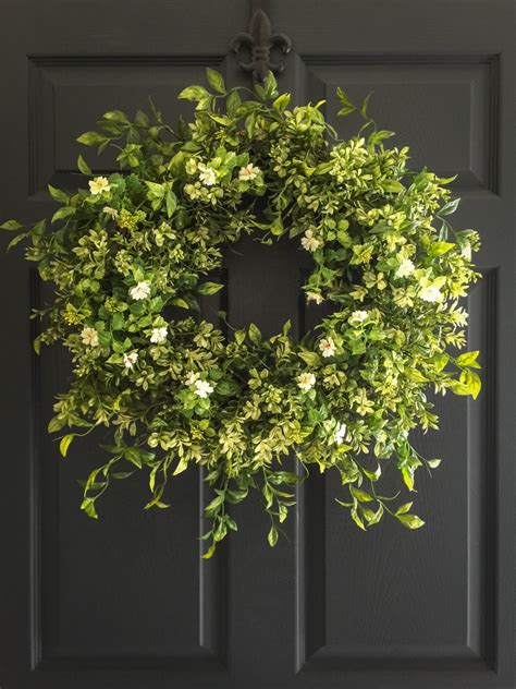 wreaths for front door boxwood wreath with white tea leaf flowers display wreath