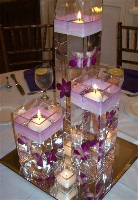 candle in water centerpiece anyone did floating water candle with vases as their