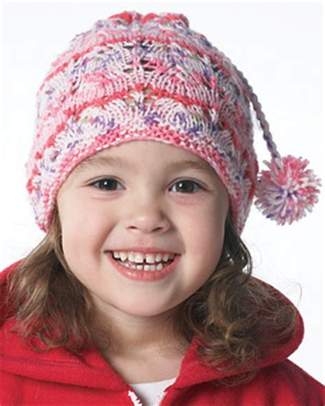 children s knitted hat patterns lacy child s hat knitting pattern favecrafts