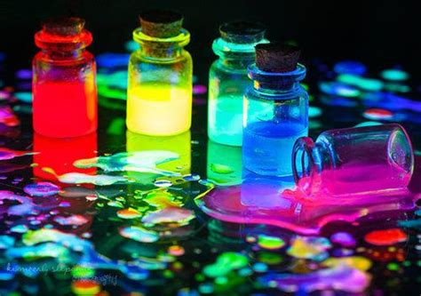 glow in the paint that lasts forever bottles of glowing liquid colorful stuff