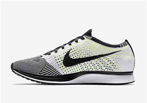 fly knit racer the nike flyknit racer in black white and volt has a
