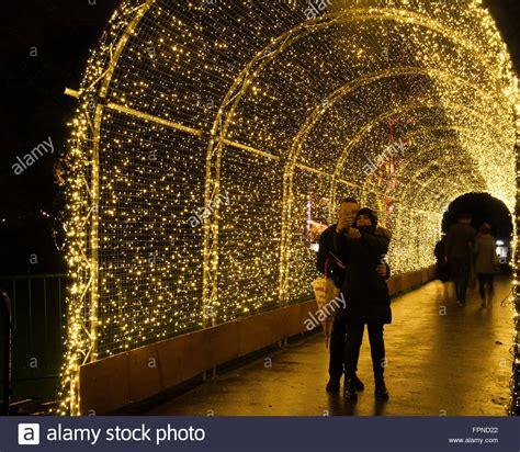 taking pictures of lights in taking selfie in tunnel of lights seasonal