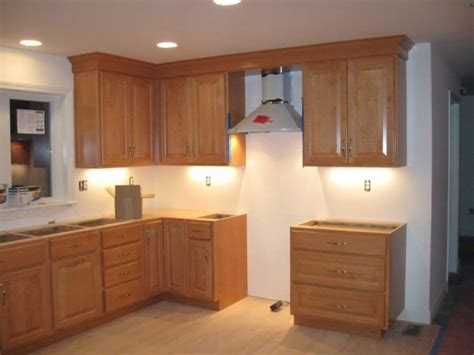 crown molding on kitchen cabinets how to attach crown mouldings to frameless cabinets