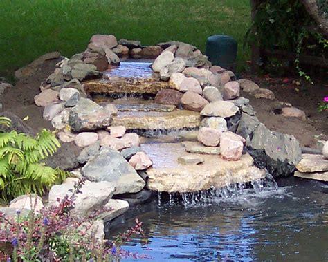 building backyard pond build a backyard pond and waterfall home design garden