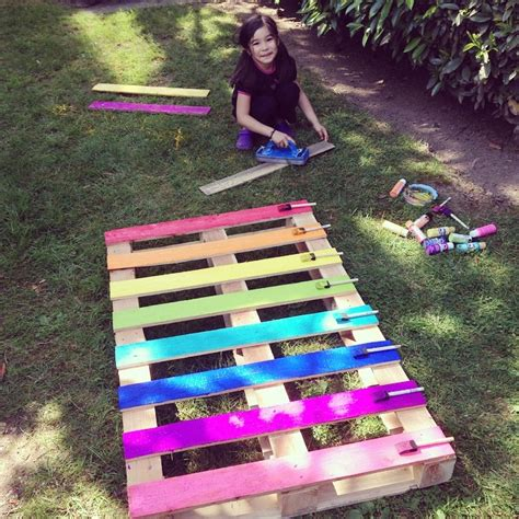 how to create a flower garden how to make a diy upcycled rainbow pallet flower garden