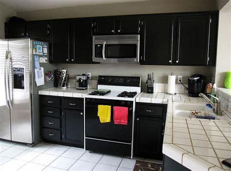 small black and white kitchen ideas white ceramic countertop and corner black cabinet for