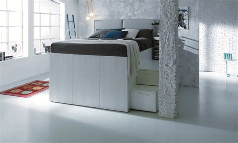 smart space saving bed hides a walk in closet underneath