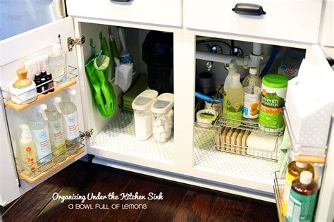 how to organize the kitchen sink organizing the kitchen sink a bowl of lemons