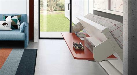 muebles con cama abatible horizontal mueble cama abatible con mesa delante y armarios arriba