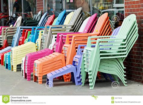 Colored Plastic Adirondack Chairs by Colorful Adirondack Chairs Royalty Free Stock Images