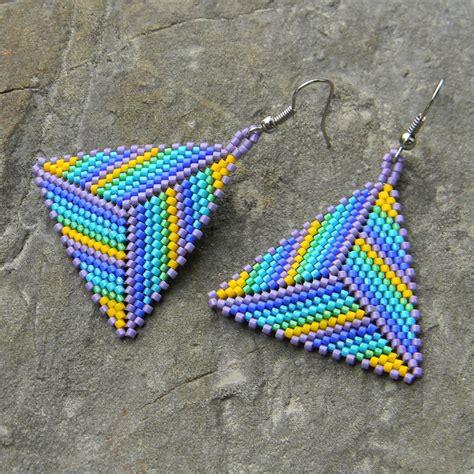 beaded triangle earrings lighting