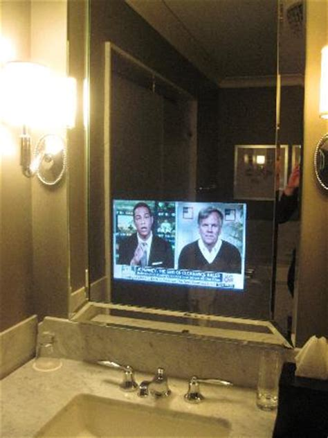 tv in the mirror bathroom elysian front lobby picture of waldorf astoria chicago