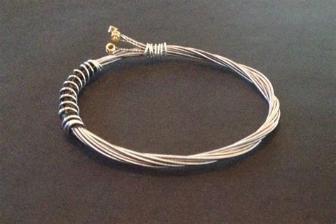 how to make guitar string jewelry a handmade recycled guitar string bracelet bangle bound with