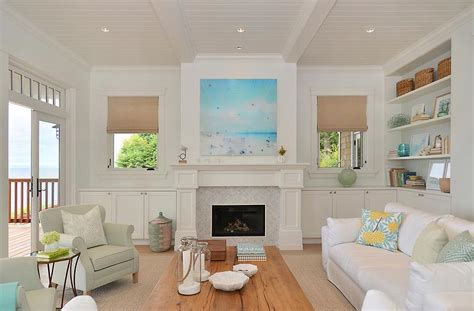 Gray Folding Chairs by Fireplace Flanked By Floating Shelves Cottage Living Room
