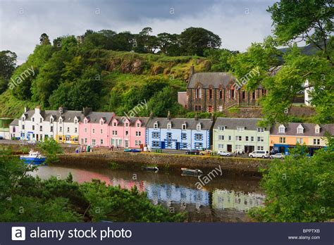 colourful houses in the harbour of portree on the isle of