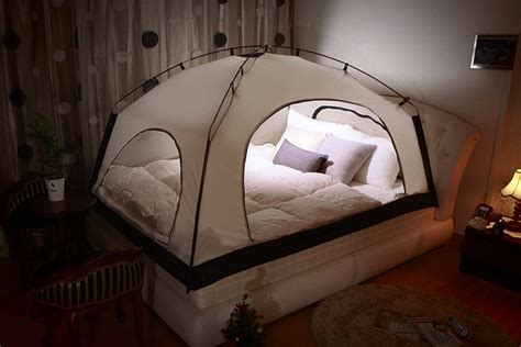 bed with tent room in room tent