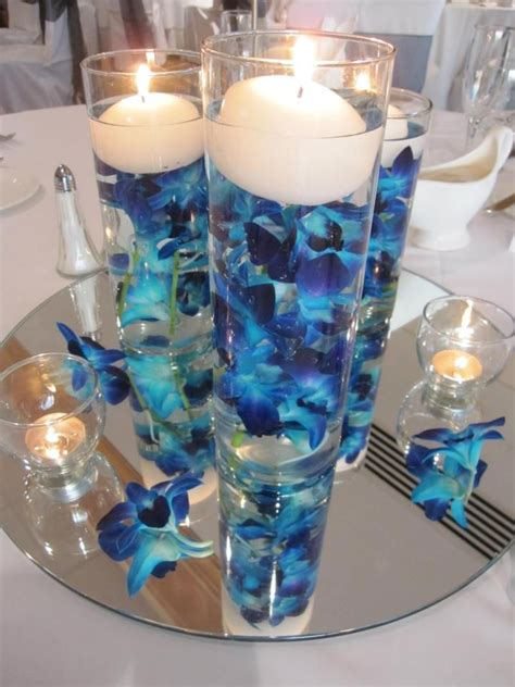 blue vases for centerpieces blue orchid centerpiece the mirror at the bottom