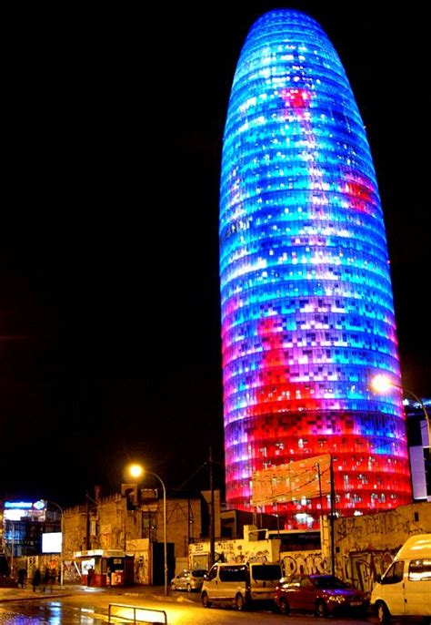 barcelona s agbar tower covered with led lighting