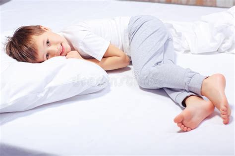 boys size bed portrait of a boy in bed with pajama stock image image