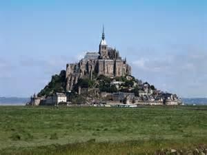 le mont st michel wind turbines on the horizon visit normandy pays de la loire