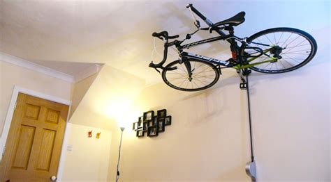stowaway stashes your bike on the ceiling to free up space in your appartment bikerumor