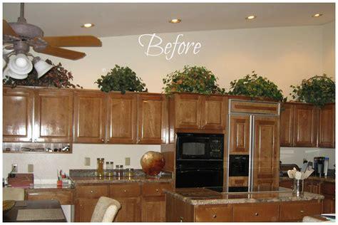 above kitchen cabinet decor how do i decorate above my kitchen cabinets la z boy