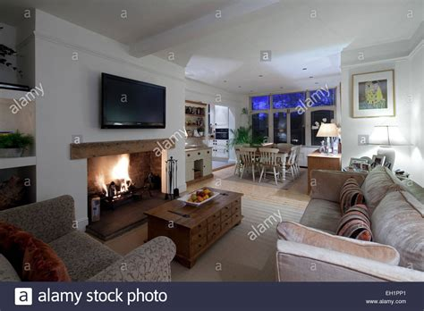 Open Plan Living And Dining Room With Plasma Screen Above Coffee Table Pieces Dark Wood With Storage Pier One Anywhere Tables Black Glass Granite Top Styling Steel Circular