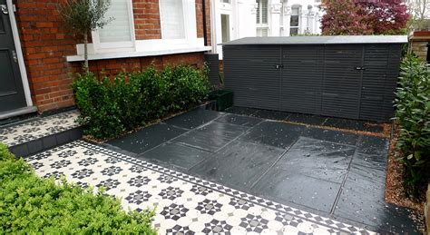 bespoke front garden bike store paving slate patio front metal wrought iron rail and