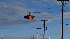 Blinking Red Traffic Light With Power Pole And Wires Stock ...