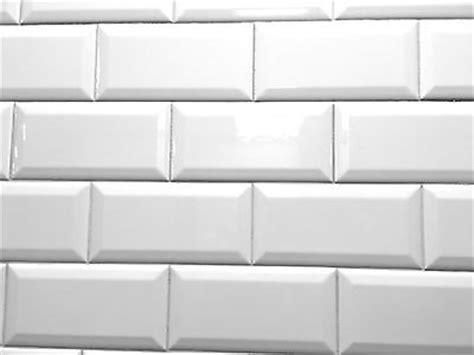 white 4x8 subway beveled ceramic tile walls and
