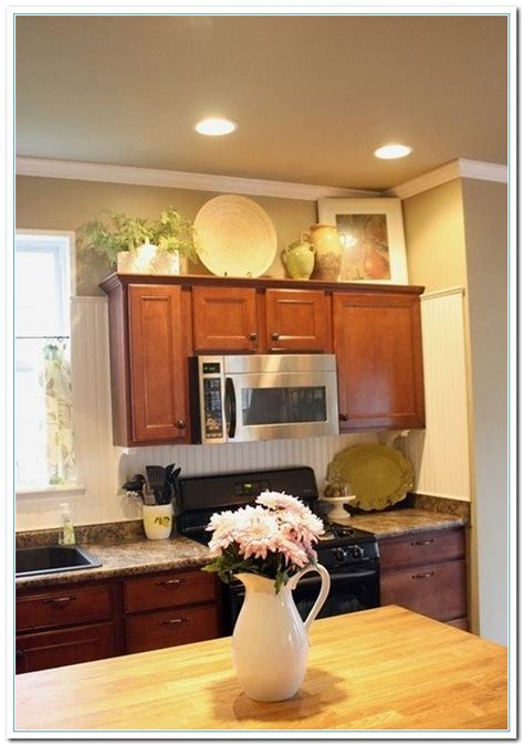 above kitchen cabinet decor 5 charming ideas for above kitchen cabinet decor home