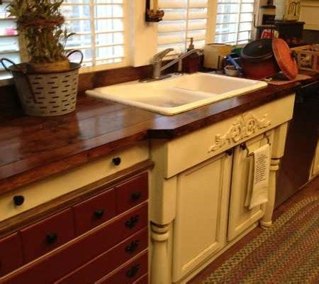 Cabinets made using old dresser and adding legs to the