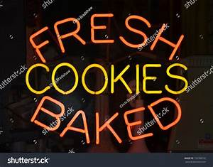 An Orange And Yellow Neon Sign Reading Fresh Baked Cookies ...