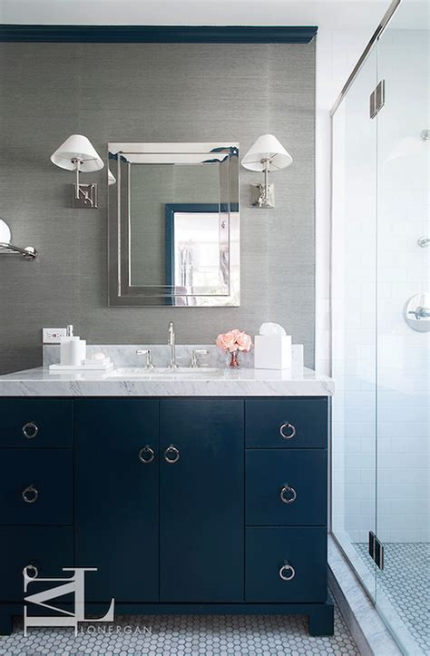 navy blue and gray bathroom features walls clad in grey grasscloth lined with a polished nickel