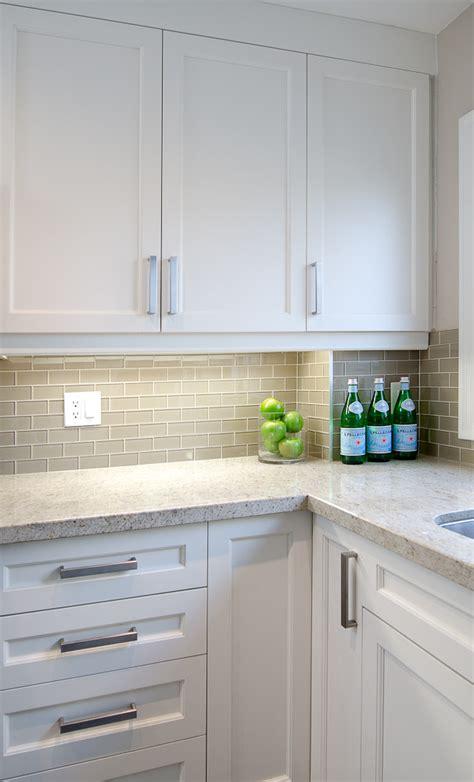 white shaker cabinets gray subway backsplash kashmir white granite countertops home decoras