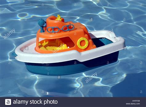 Toy Boat For Pool colorful toy boat floats in swimming pool stock photo
