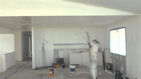 spray painting a ceiling how to paint a ceiling the easy way by using an airless spray gun