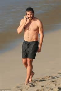 Jake Gyllenhaal topless in the ocean with pal Greta Caruso ...