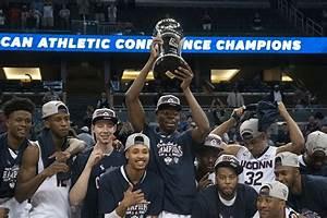 Men's Basketball: Huskies down Memphis for first AAC title ...