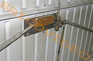mecanisme fermeture porte garage basculante