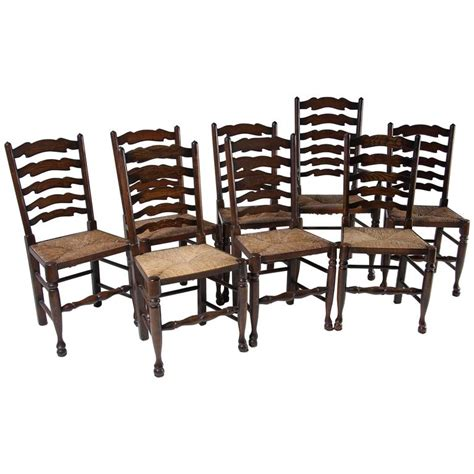 set of eight antique ladder back oak dining chairs all with seats at 1stdibs
