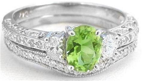 Vintage Inspired Peridot And Oval Diamond Engagement Ring. Hawaiian Wood Engagement Rings. 1.1 Carat Engagement Rings. Wedding Bell Wedding Rings. Blue Sapphire Wedding Rings. Realistic Rings. New Engagement Rings. Skull Wedding Rings. Brilliant Engagement Rings