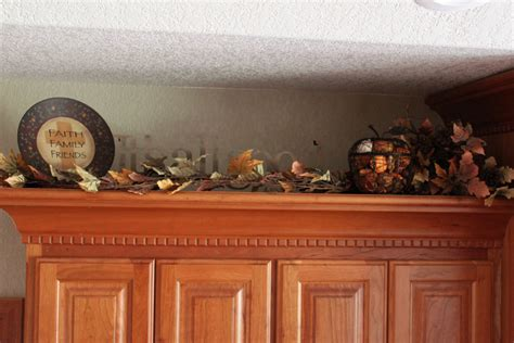 above kitchen cabinet decor decor on top of kitchen cabinets home design and decor
